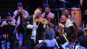 This picture from the Proms website beautifully illustrates  the collaboration between Kennedy and the young musicians from Palestine Strings. BBC/Chris Christodoulou